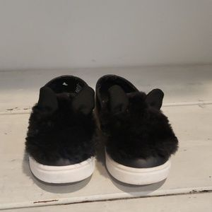 Black fuzzy sneakers